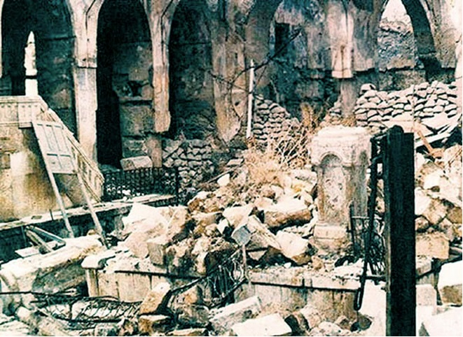 The Great Synagogue of Aleppo is in ruins after a mob broke in Nov. 30, 1947, and destroyed Torah scrolls and badly damaged the thousand-year-old Aleppo Codex.