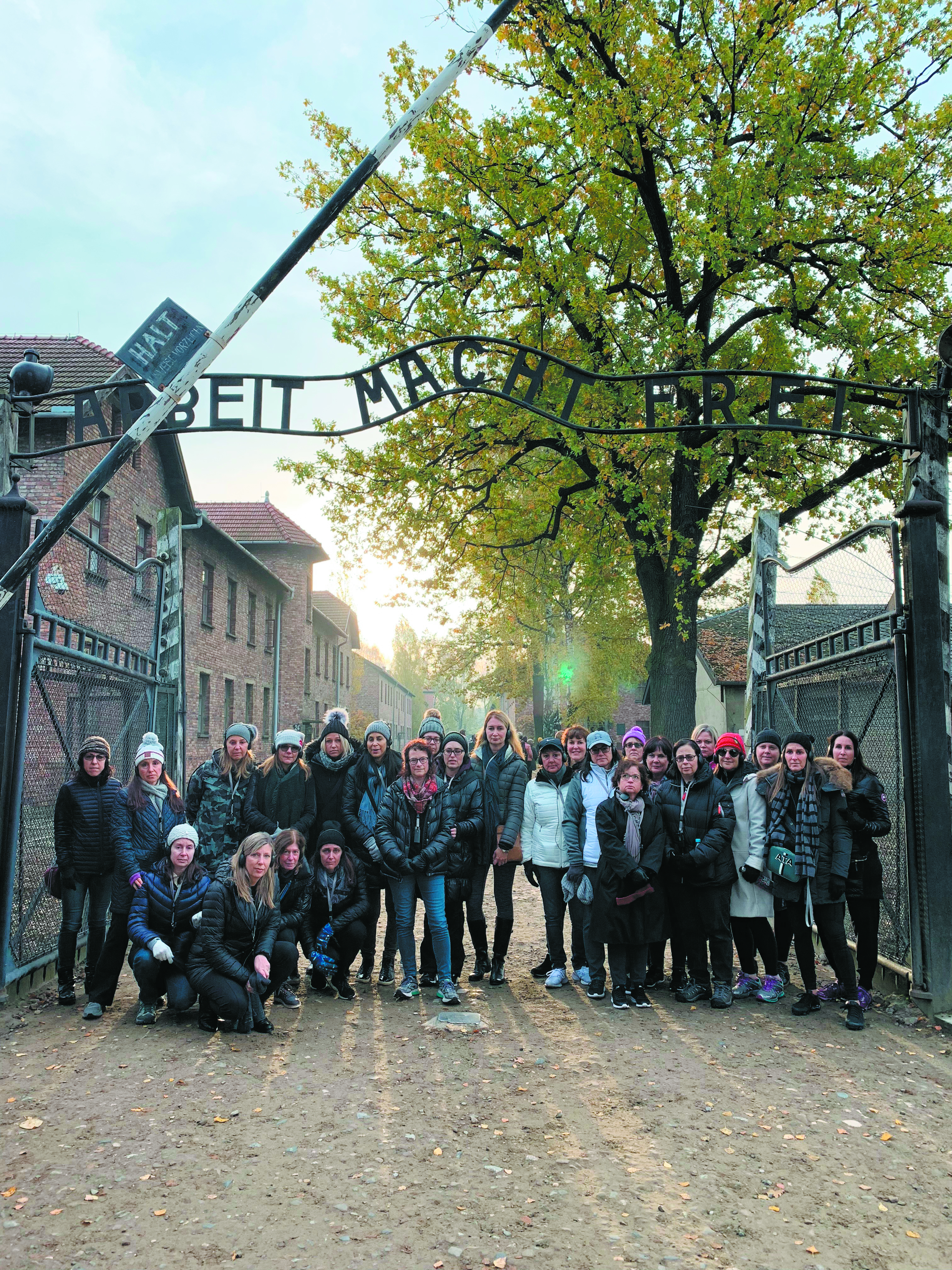 Temple Israel women's mission participants at the gates of Auschwitz.