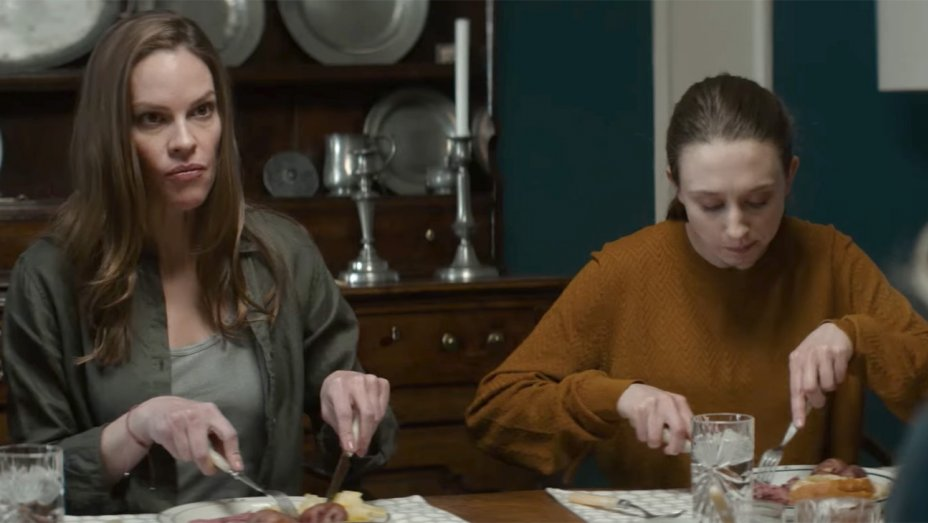 still from the movie What They Had with two characters eating dinner. On the left is Bridget played by Hilary Swank. On the right, another woman.