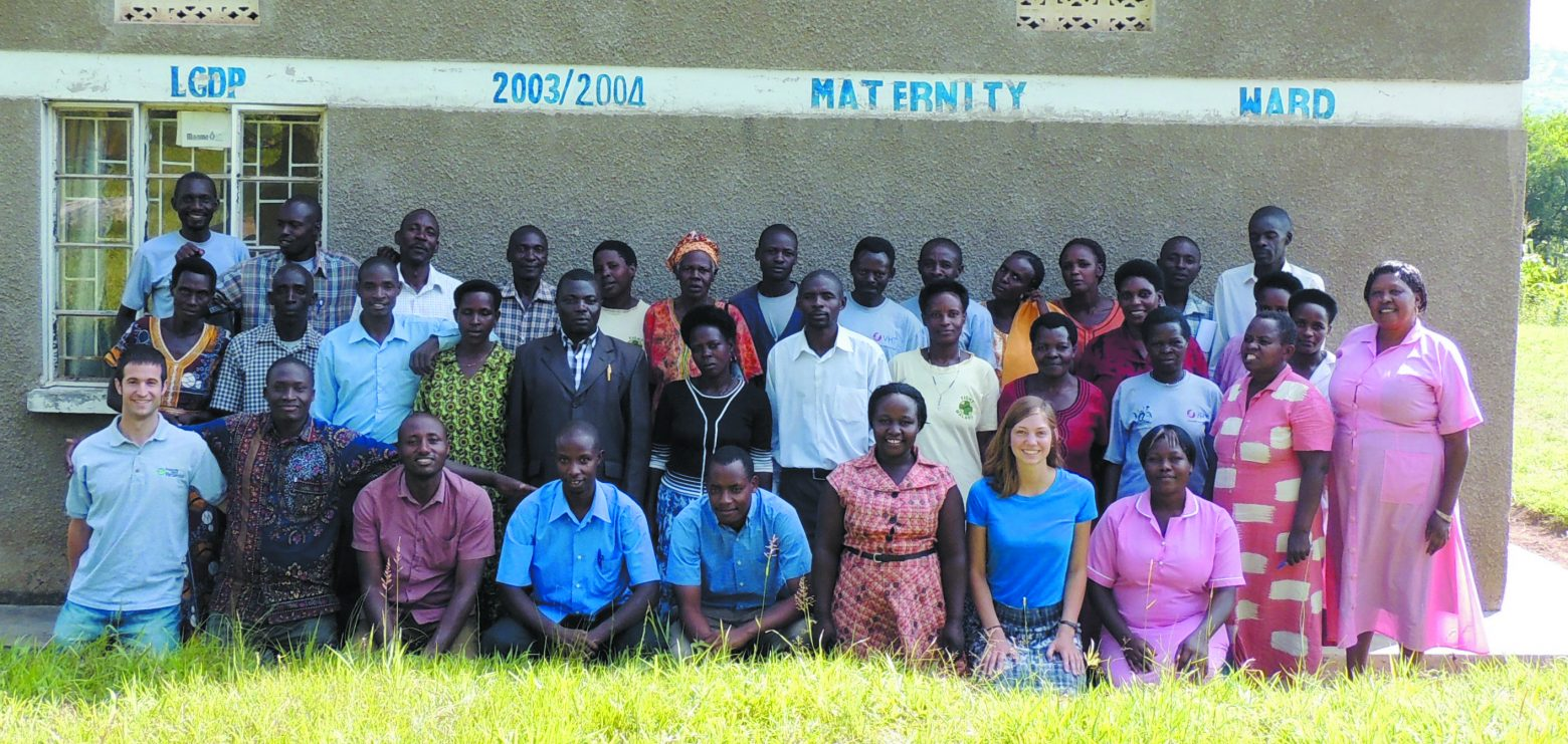 Josh Greenberg, left, front row, with the whole Progressive Health Partnership team in Uganda. Many African people in a row smiling for the camera.
