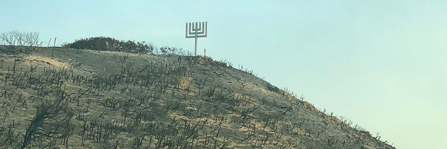 Camp Kramer's wooden menorah still stands after the surrounding camp burned down.