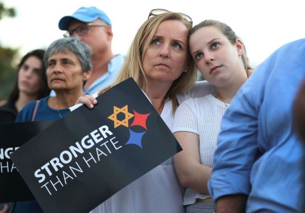 Iris Schaen and Jenny Schaen hug as they join with others for a Community-Wide Solidarity Vigil at the Holocaust Memorial Miami Beach to remember the victims of the mass shooting at a Pittsburgh temple on October 30, 2018 in Miami Beach, Florida.