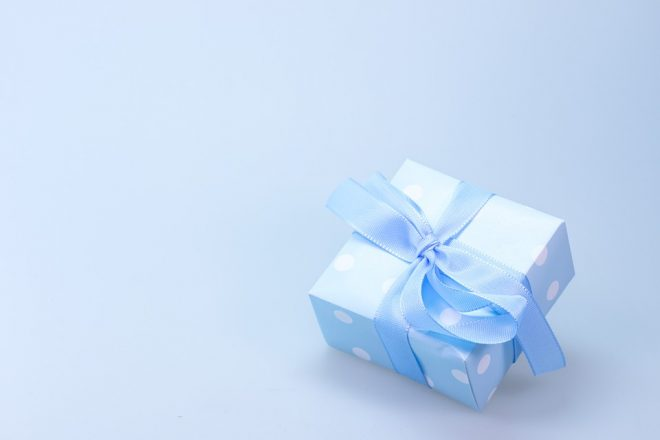 small wrapped gift with a bow on it.