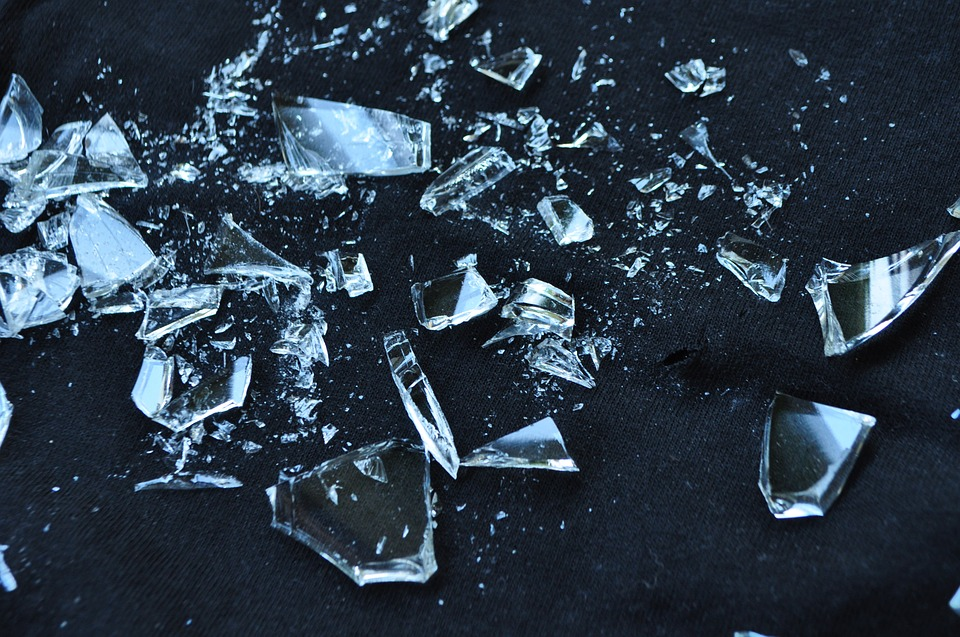 "broken glass to represent Kristallnacht (commonly translated as ""Night of Broken Glass"")"