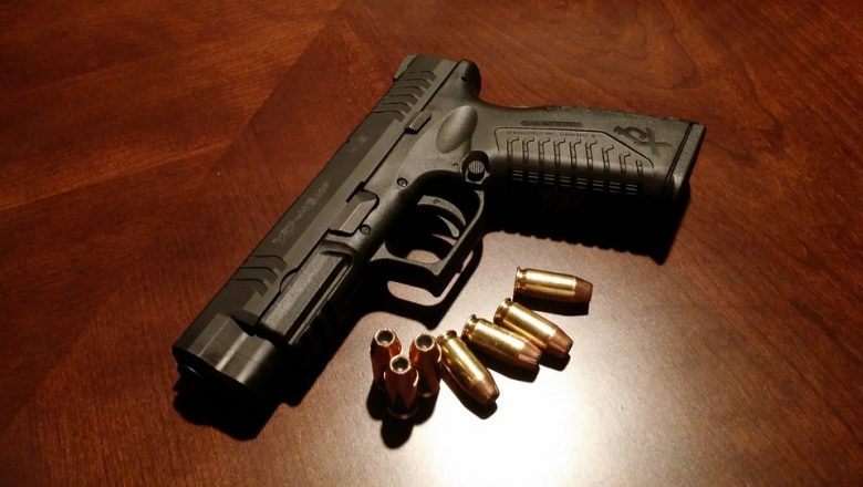 pistol with bullets on a table