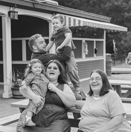 CLOCKWISE FROM TOP LEFT: Adam Magy holding Henry Magy, 4, Karen Gasinski, Kristi Magy holding Zelda Magy, 2. Family smiles and poses all together