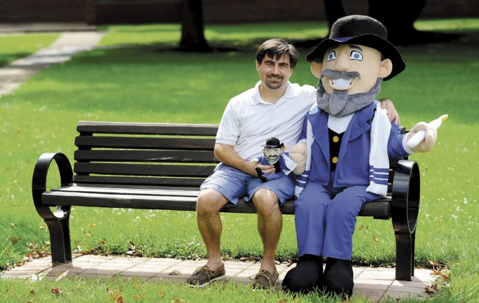 Creator Neal Hoffman with Mensch on a Bench