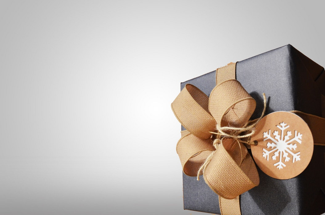 present wrapped in a bow with a tag that has a snowflake on it