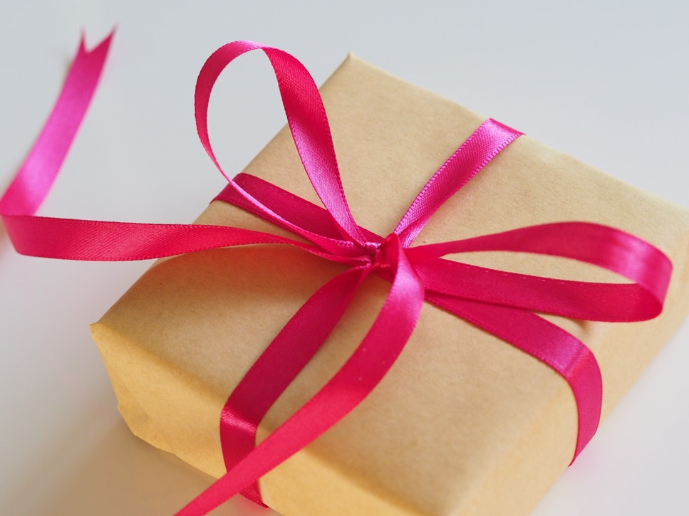 wrapped gift with a bow ribbon around it.