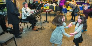 Jack and Hannah Waterstone of Oak Park play Jewish dance songs while 5-year-olds Eden Tishkowski and Deedee Lefkowitz, both of Oak Park, dance.