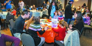 Families are busy at work on Chanukah decorations.
