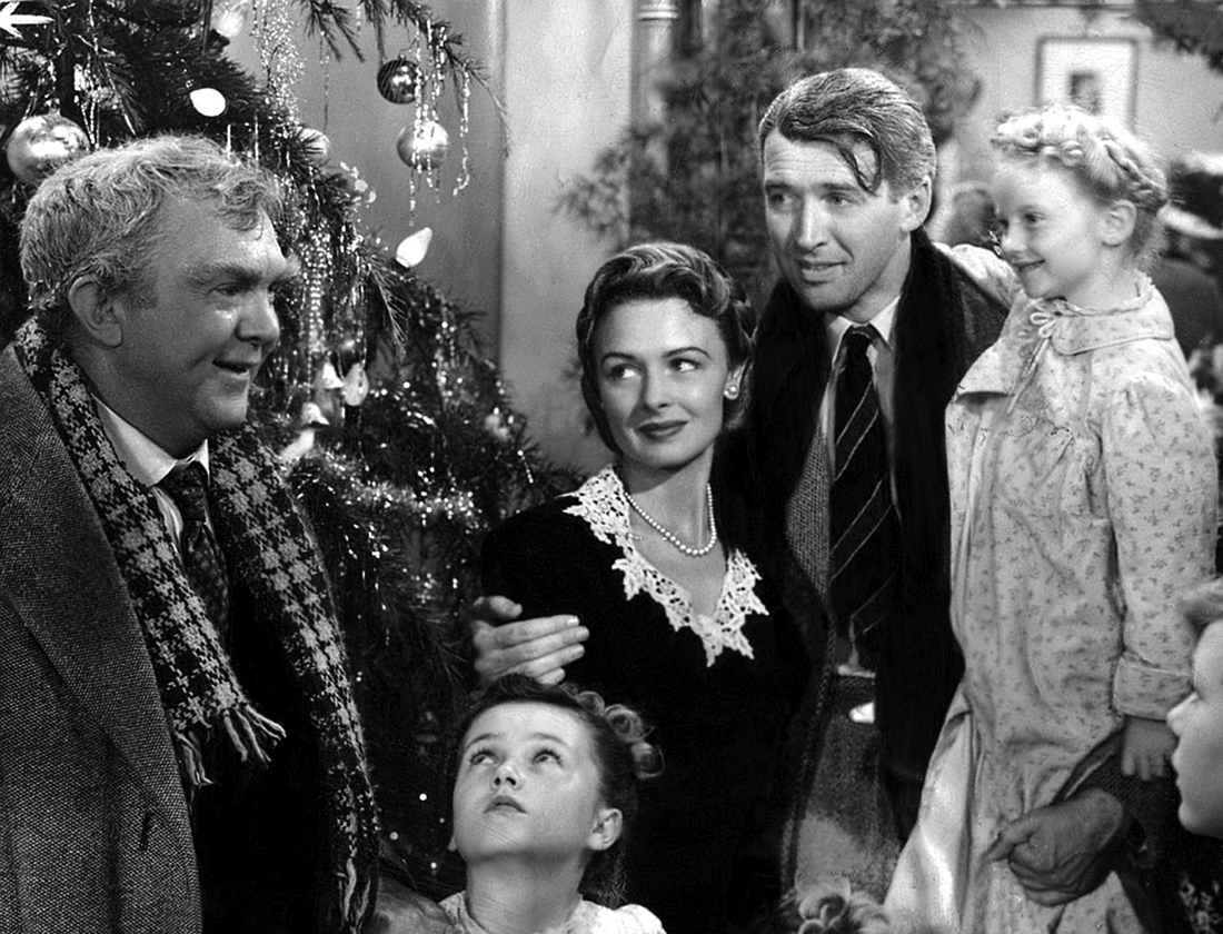 Scene from the movie It's a Wonderful life showing the characters all smiling together