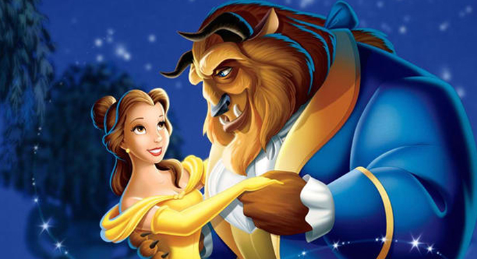 Belle and the Beast dance together in a scene from Beauty and the Beast