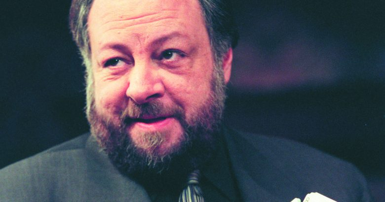 Ricky Jay - close up on his face with him in a full beard and mustache looking off into the distance