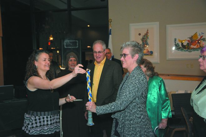 Rabbi Aura Ahuvia, Br. Al Mascia, Chazzan Steve Klaper of Song and Spirit Institute for Peace and congregant Jan Laurencelle light the Havdalah candle.