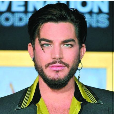 Adam Lambert - man with floppy hair and goatee and earring.