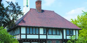 Pewabic Pottery building in tudor style on a mostly clear day
