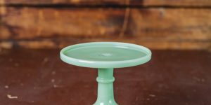 light green cake stand on a wooden table