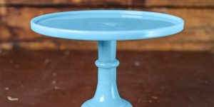 robin's egg blue cake stand on a wooden table