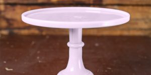light pink cake stand on a wooden table