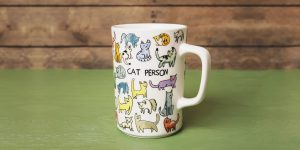 """Cat Person Mug with a lot of illustrated cats on it and the words """"Cat person"""""""