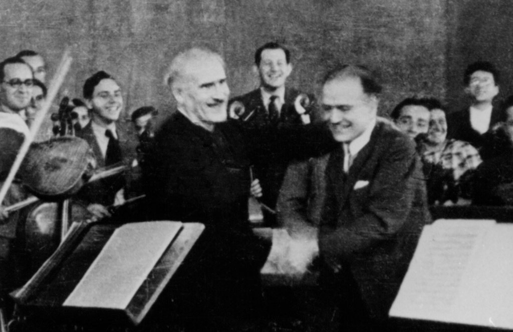 Arturo Toscanini (left) is congratulated by violinist Bronislaw Huberman after the opening performance of the Palestine Philharmonic on Dec. 26, 1936.