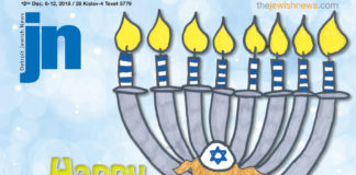 """December 6, 2018 Detroit Jewish News cover with a menorah and a dog dressed with a kippah and tallit and the words """"Happy Chanukah! 5779"""""""