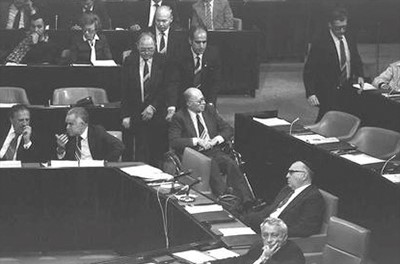 A day after surgery on a broken hip, Prime Minister Menachem Begin arrives in a wheelchair for the Knesset vote on annexing the Golan Heights on Dec. 14, 1981.