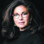 Lori Kanat Edelson - a woman with dark, long hair and glasses