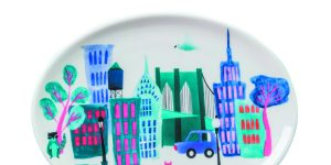tray with an illustration of New York City buildings and a bridge with a cat in the front
