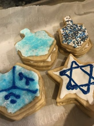 Chanukah cookies decorated to look like dreidels and stars of David