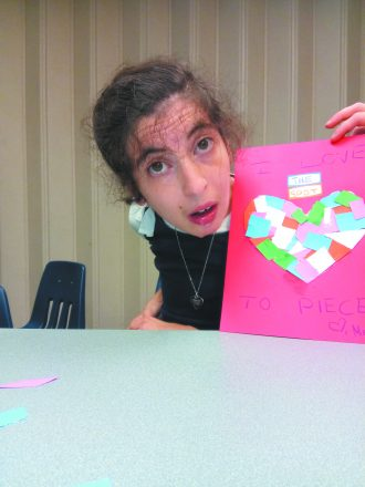 Meira Hurvitz shows her love for The Spot with an art piece with a cut out heart