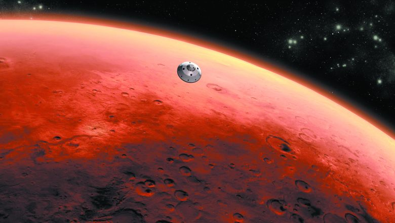 An artist's concept of the Mars Science Laboratory spacecraft approaching Mars. A large planet with a small spacecraft in the front