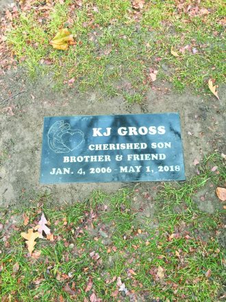 """KJ Gross's tombstone reading """"cherished son brother & friend Jan. 4, 2006 - may 1, 2018"""