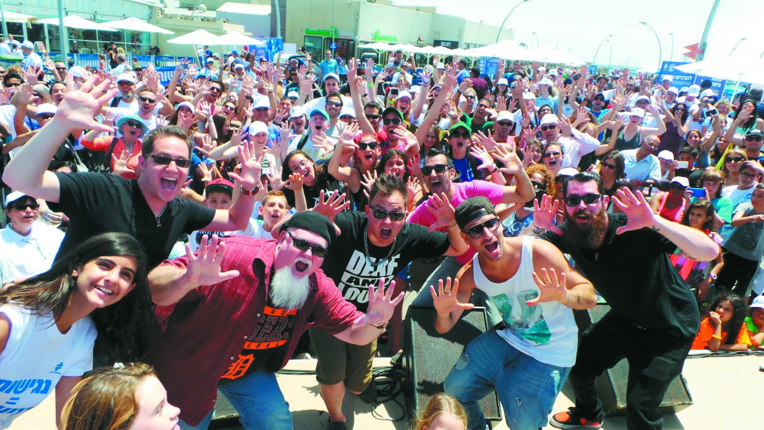 Sean Forbes, center, and Jake Bass, left, perform in Tel Aviv to a large crowd of excited concert goers