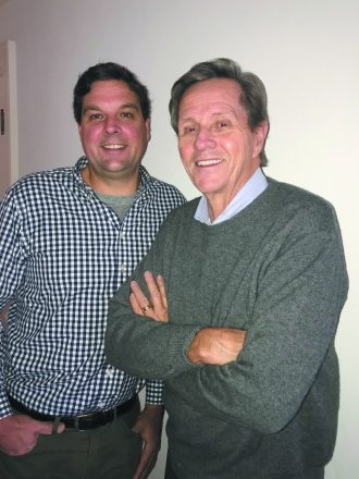 Pat Liebler and Bud Liebler - two men smile together, one has his arms crossed