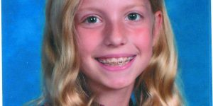 Zoey Kapeller - blonde girl smiling with long hair in a school-style photo