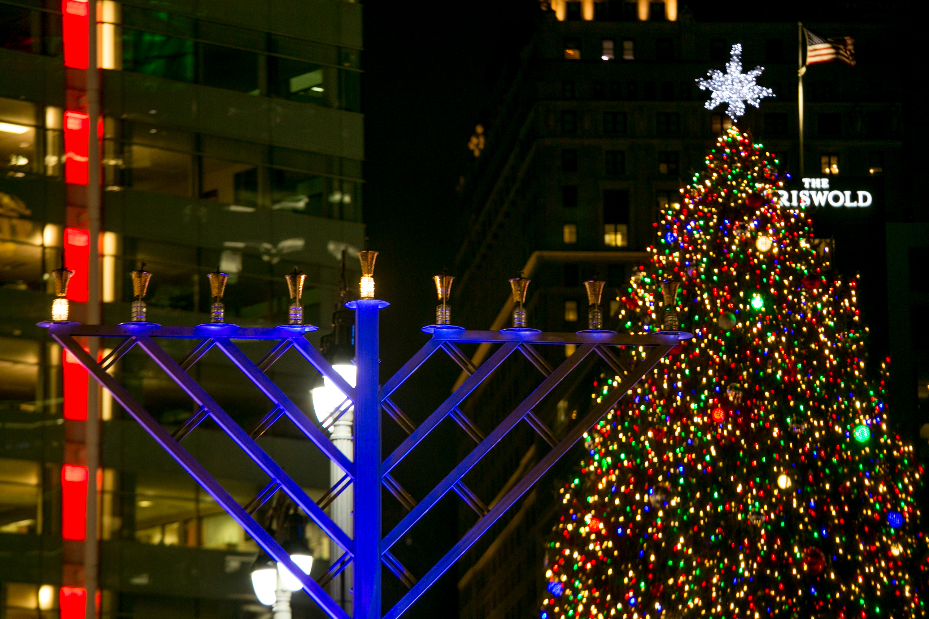Campus Martius was the scene of Menorah in the D. The light shines on the first night of Chanukah, with the city's Christmas tree in the background.