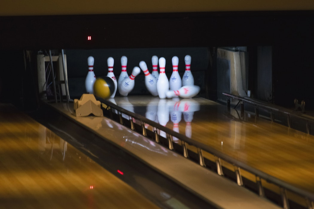 bowling alley showing bowling ball hitting the pins
