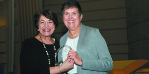 Diane Klein presents the Volunteer of the Year award to Addie Levine.