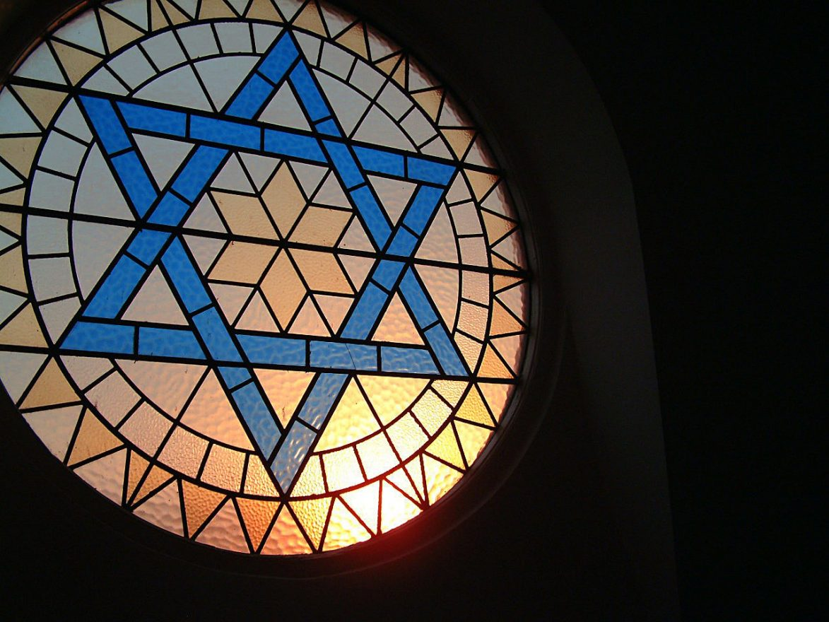 stained glass window of a Star of David in a synagogue