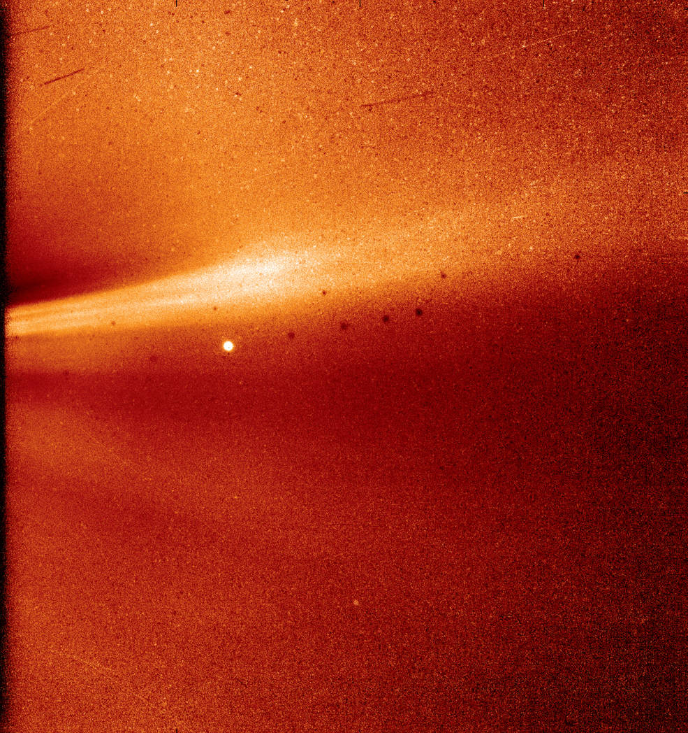 Parker Solar Probe acquired this image – 1st-ever photo taken from inside the sun's outer atmosphere, or corona – on December 8, 2018. The bright streak is a coronal streamer. The bright object near the center is the sun's innermost planet, Mercury. The dark spots are a result of background correction. Image via NASA/Naval Research Laboratory/Parker Solar Probe.