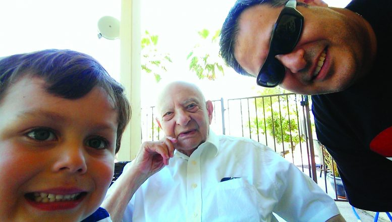 Dr. Adam Brish, center, celebrates his 90th birthday with son Harry and grandson Solomon.