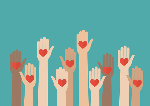 raised hands with hearts to represent volunteering