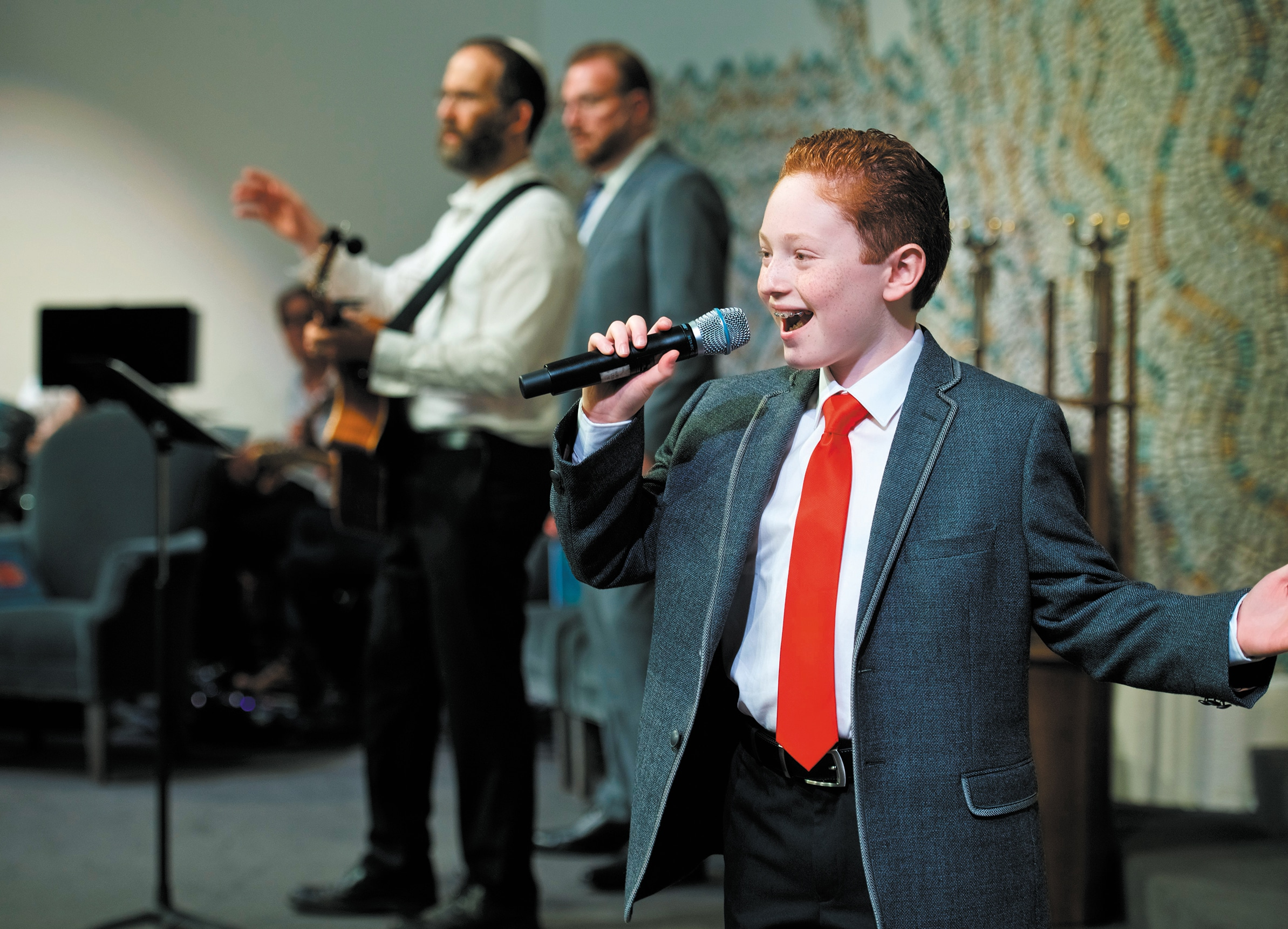 Cameron Klein singing at Temple Israel