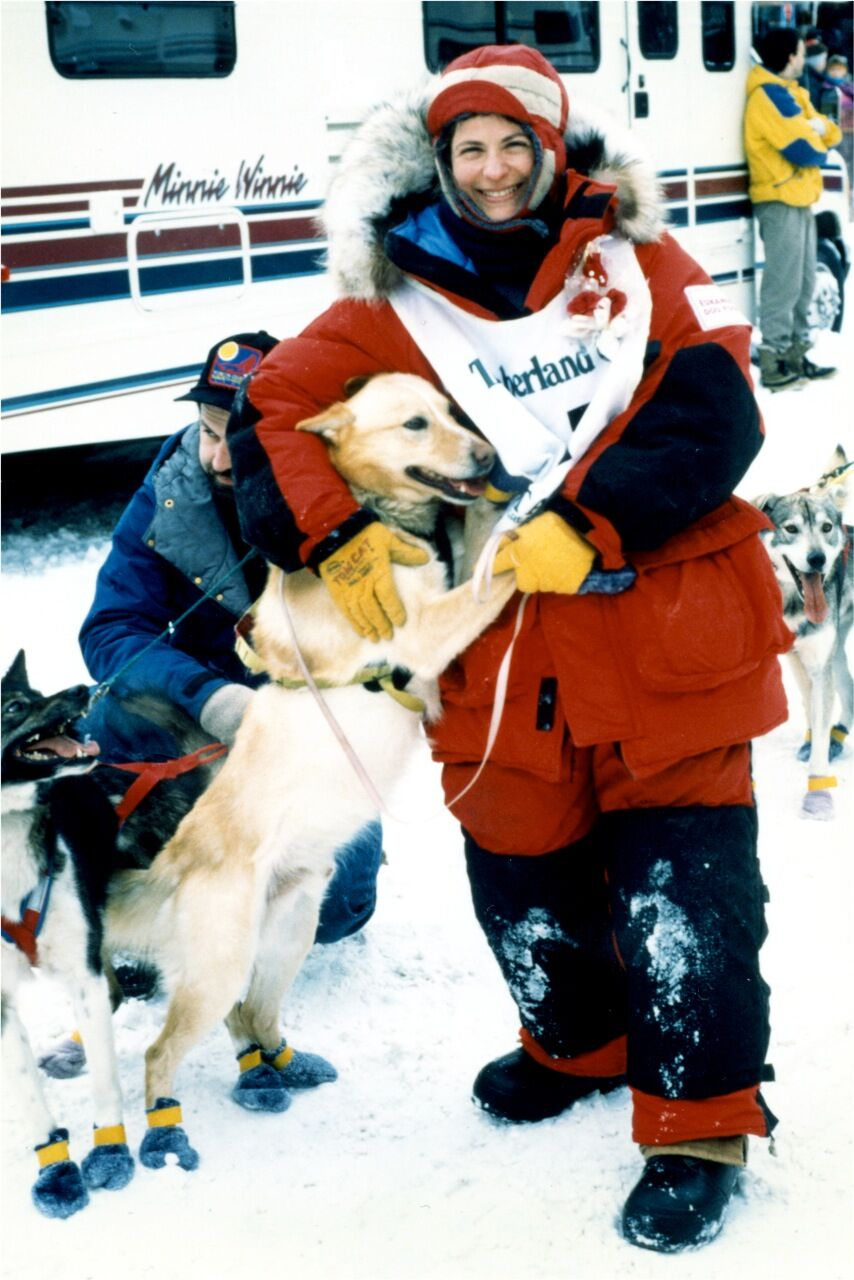 Susan Cantor with dog at iditarod race