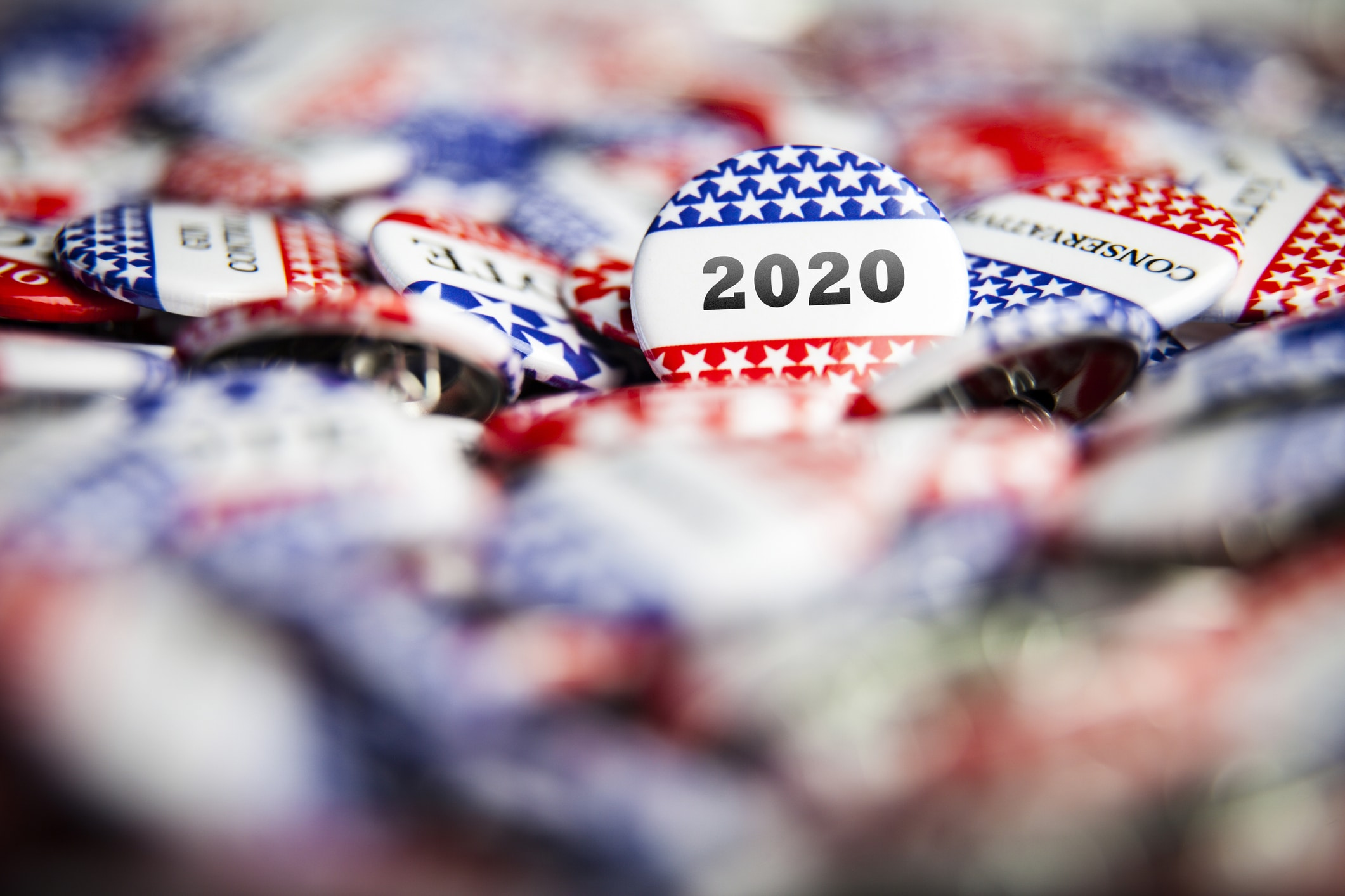Closeup of election vote button with text that says 2020
