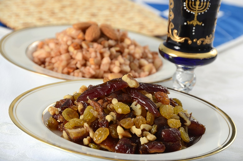 A Sephardic charoset made of dates, raisins, and walnuts, used in the Passover seder. In the background is a traditional Ashkenazi charoset of apples, nuts, cinnamon, and wine.More Passover images:""