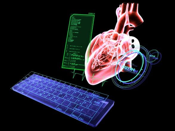 Digital keyboard, virtual screen and living heart MRI on black background. Heart attack research technology in the near future.