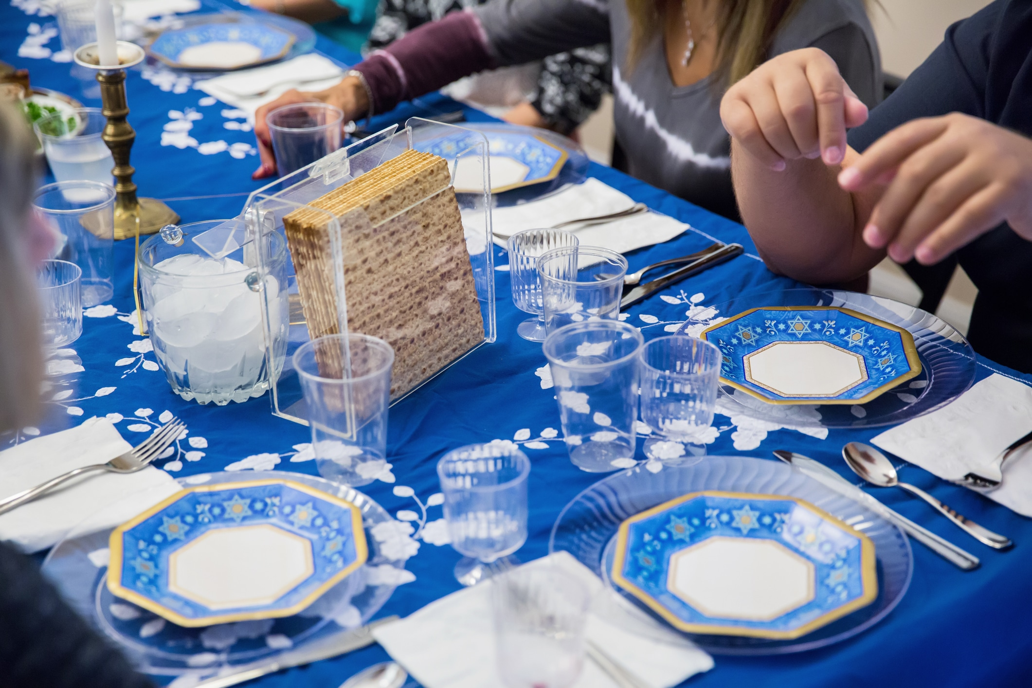 Participating in a seder at a table set for a traditional Passover